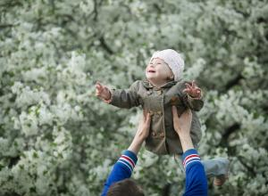 Young boy with Down Syndrome being lifted up