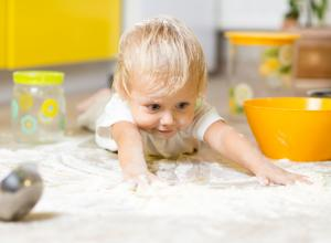 Infant crawling in flour