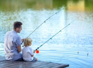Parent and child fishing.