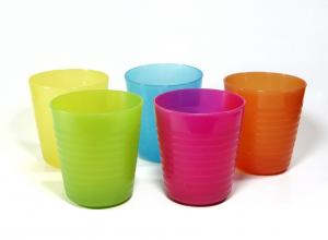 Colourful plastic cups on a white floor and background.