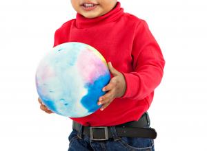Child holding a ball.