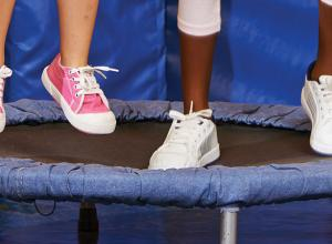 Children's feet jumping on a trampoline