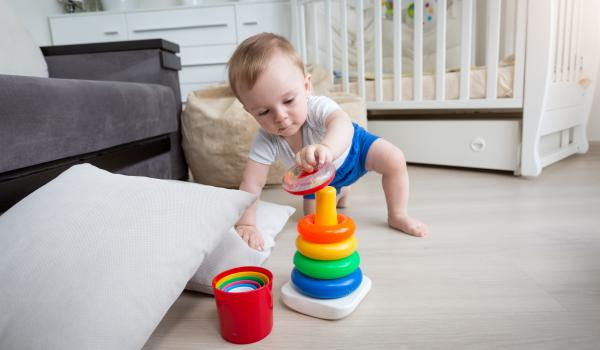 Infant developing movement skills of reaching and crawling