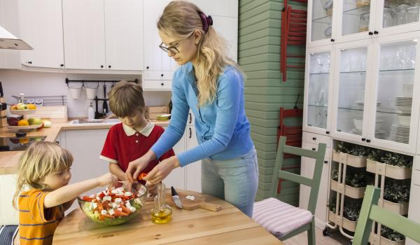 Parent cooking with children.