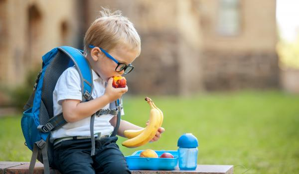 Child eating apple.