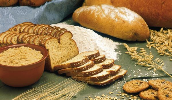 A variety of whole grain breads on a table.
