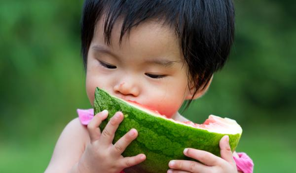 Child eating watermelon.