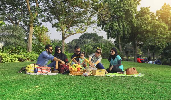 Family going on a picnic together.
