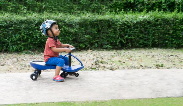 Child on a tricycle.