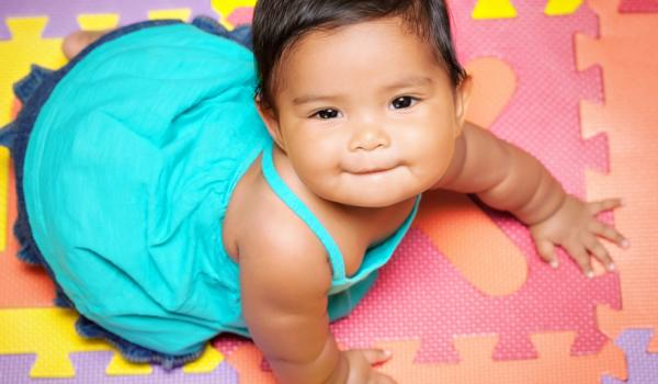 Baby on colored mats
