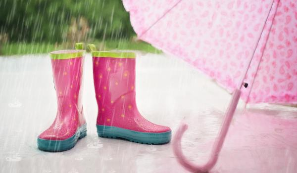 Rain boots, umbrella and falling rain.