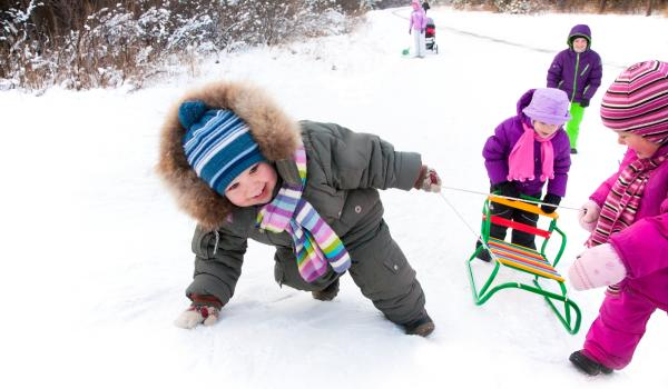 Children playing in snow.