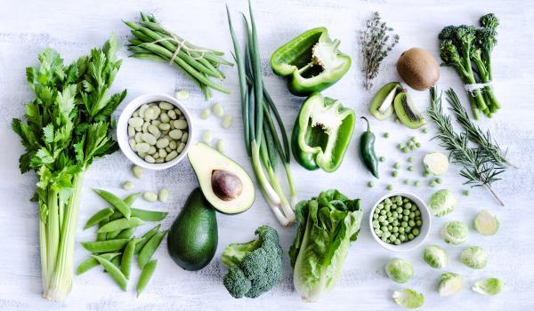 A variety of foods that are green in colour on a white background.