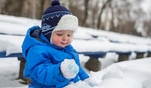 Child looking at snow.