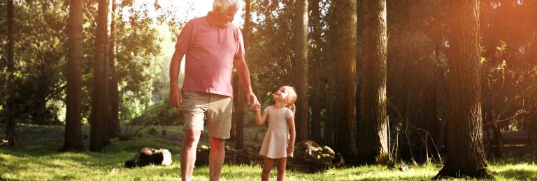 Girl and grandfather in the park
