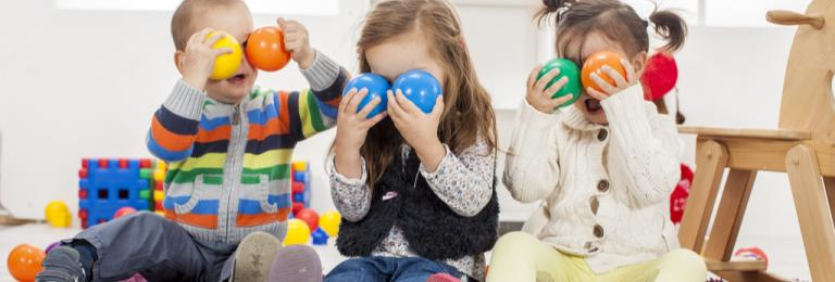 Toddlers in EY setting with colored balls