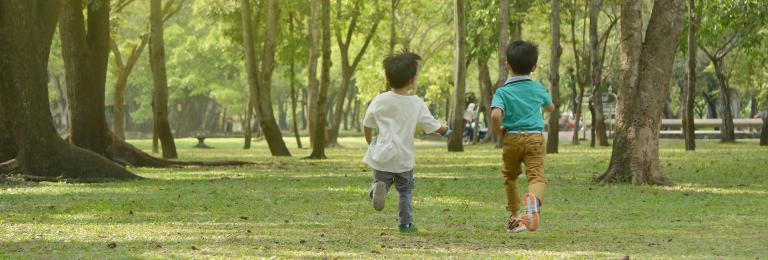 Kids running in park.